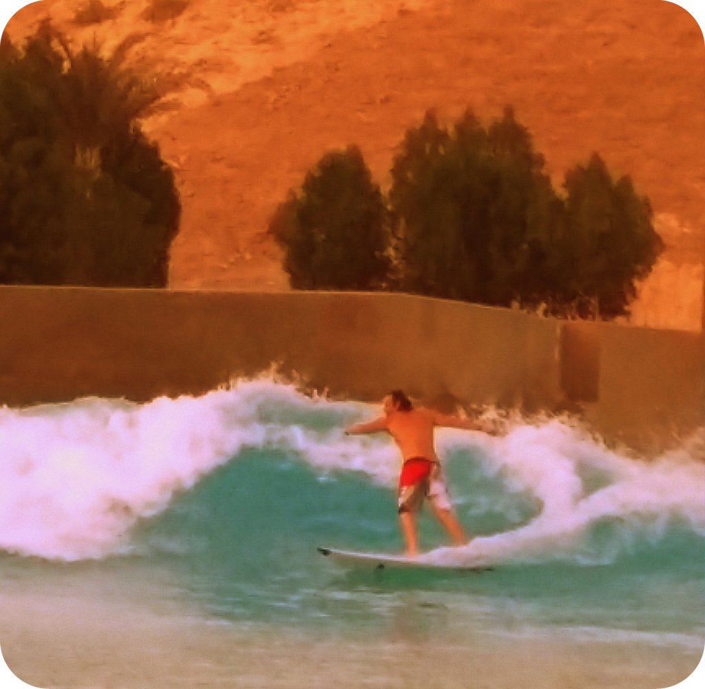"Trent Webb surfing ""The Breakwater."" Abu Dhabi."