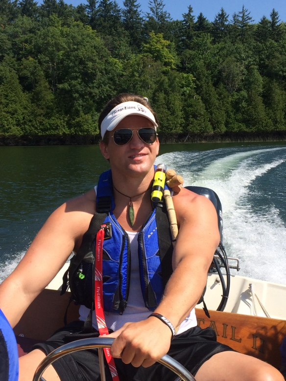 Mike Ballard boating on Lake Ann.